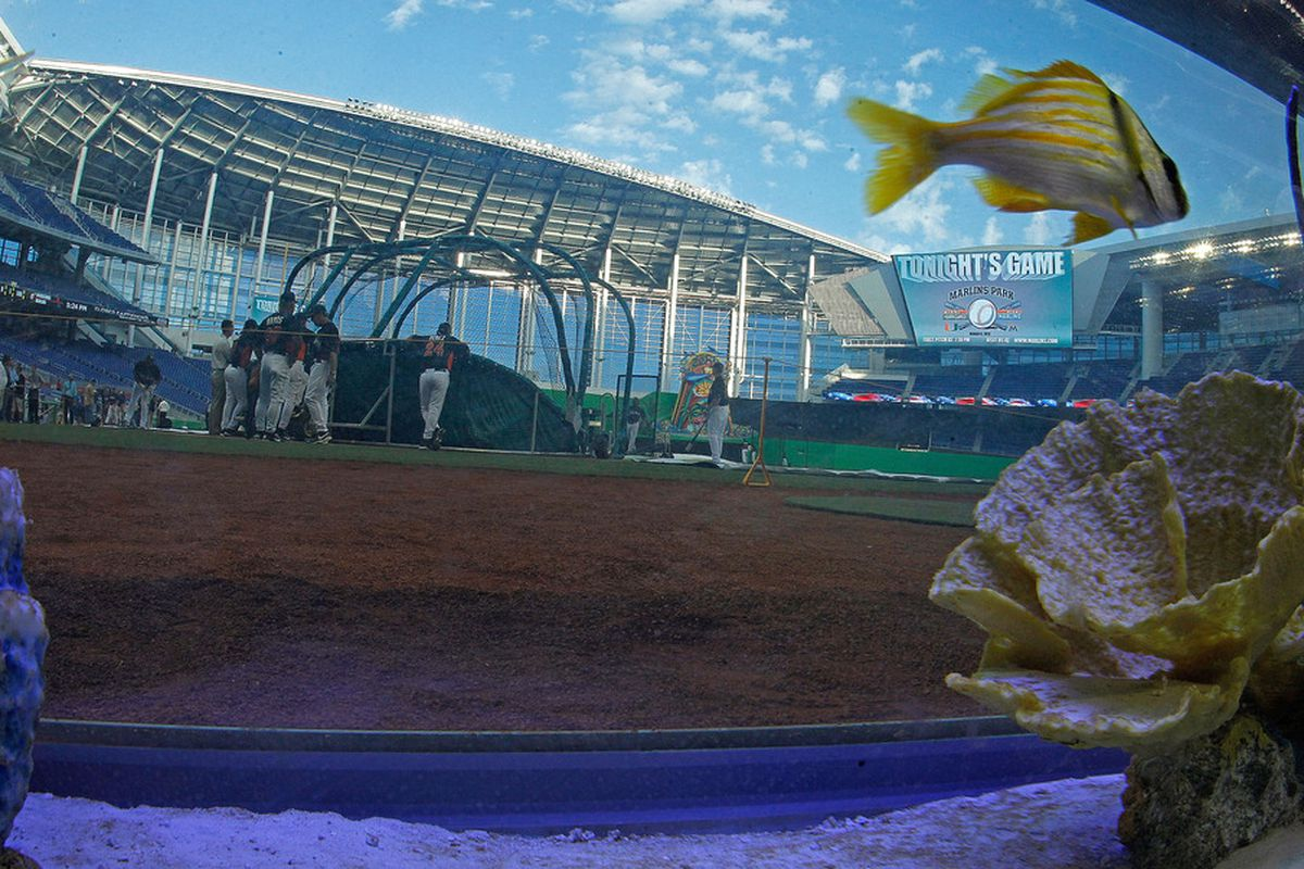 A general view of the new Marlins Ballpark shot throught a fishtank behind home plate.  (Photo by Mike Ehrmann/Getty Images)