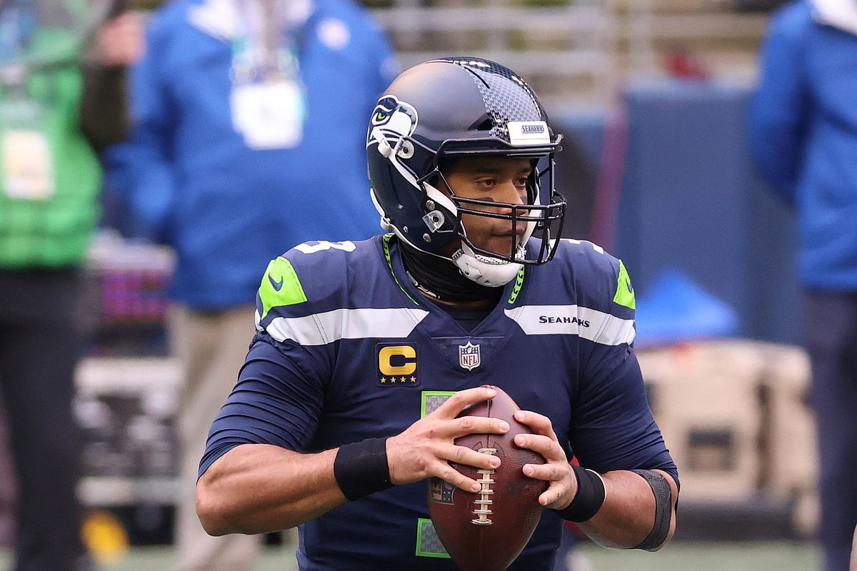Russell Wilson #3 of the Seattle Seahawks looks to throw the ball in the first quarter against the Los Angeles Rams during the NFC Wild Card Playoff game at Lumen Field on January 09, 2021 in Seattle, Washington.