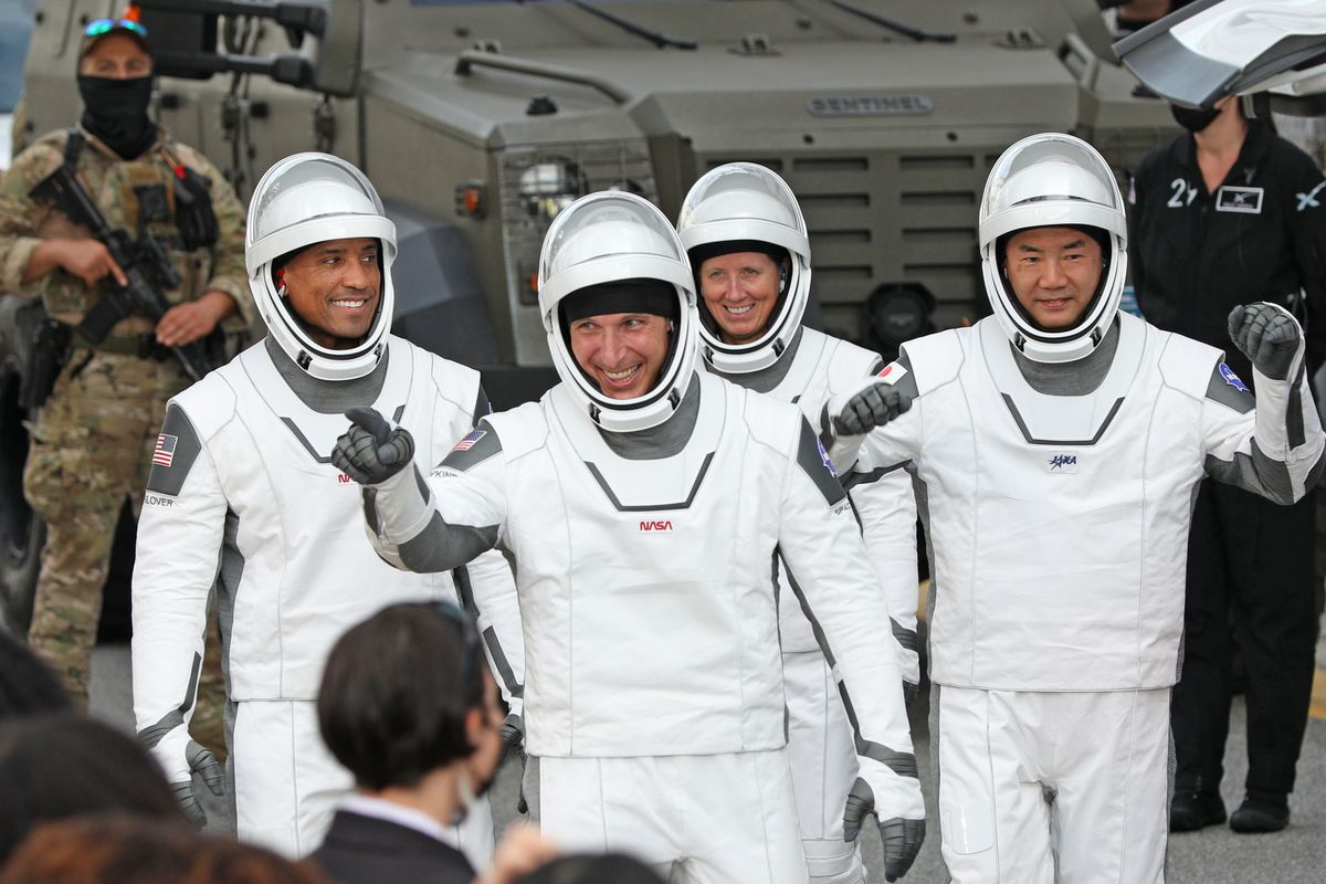 Crew-1 mission astronauts (L to R) Victor Glover, Michael Hopkins, Shannon Walker and Japanese astronaut Soichi Noguchi, walk out of the Neil A. Armstrong Operations and Checkout Building en route to launch complex 39A at the Kennedy Space Center in Florida on November 15, 2020.