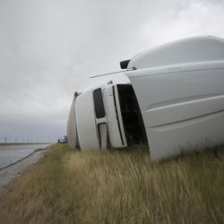 A semitrailer lays on its side after being toppled by the wind on I-80 near Dugway on Monday, June 12, 2017.