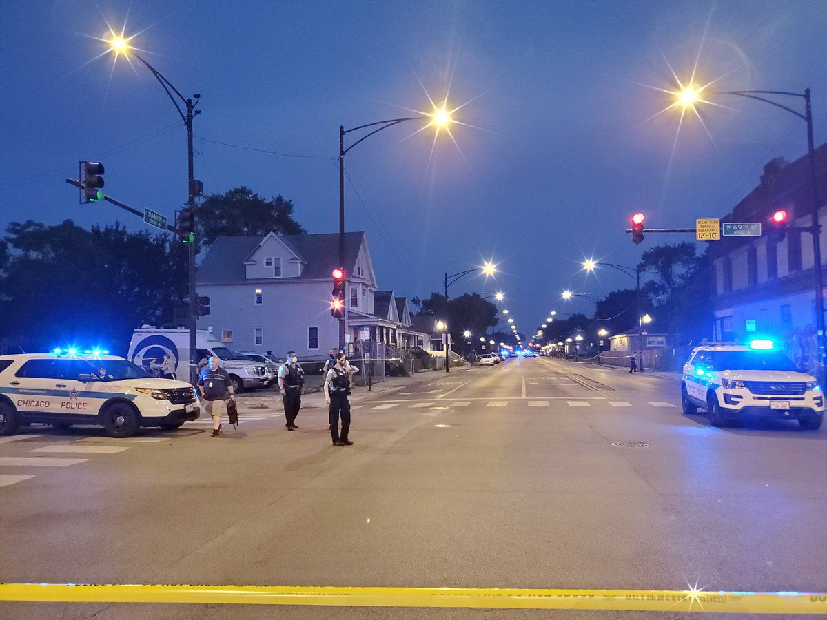 Chicago police investigate the scene of a shooting in West Englewood in June.