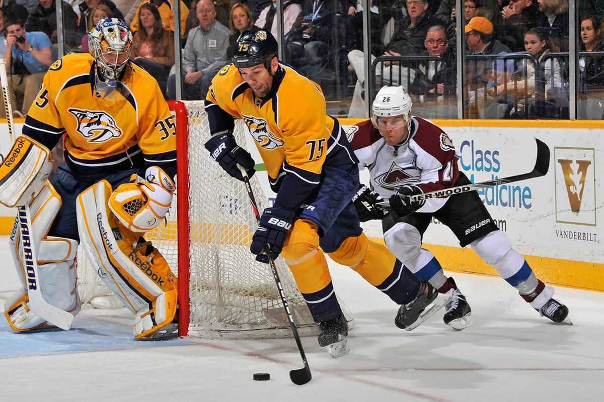 NASHVILLE, TN - MARCH 08:  Hal Gill #75 of the Nashville Predators carries the puck past Paul Stastny #26 of the Colorado Avalanche at Bridgestone Arena on March 8, 2012 in Nashville, Tennessee.  (Photo by Frederick Breedon/Getty Images)