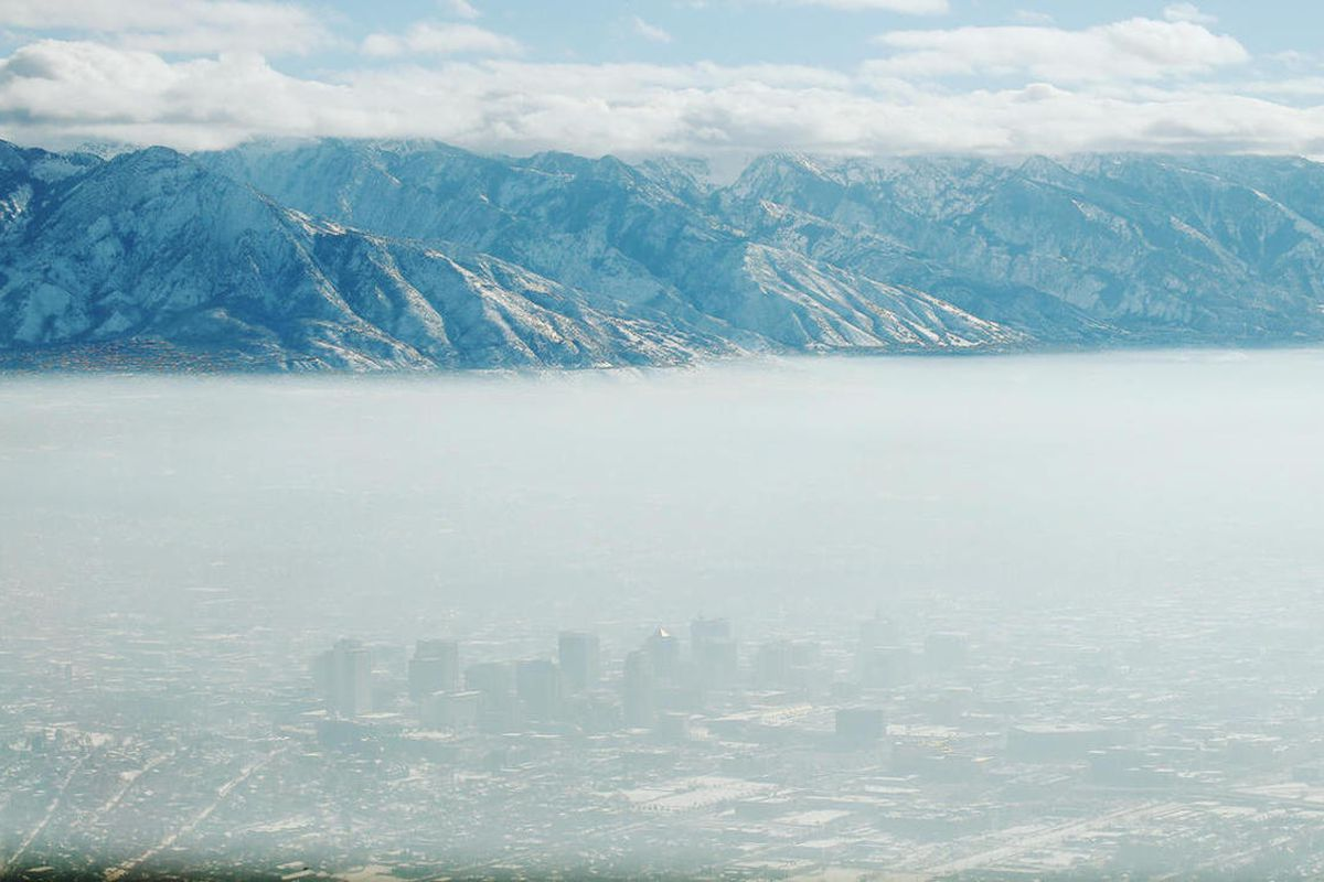 FILE — The downtown Salt Lake skyline is obscured by an inversion on Wednesday, Dec. 28, 2016.