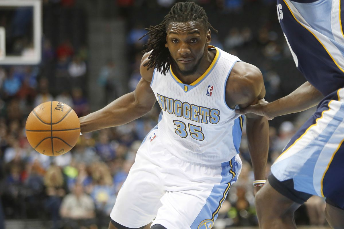 Kenneth Faried drives to the hoop.