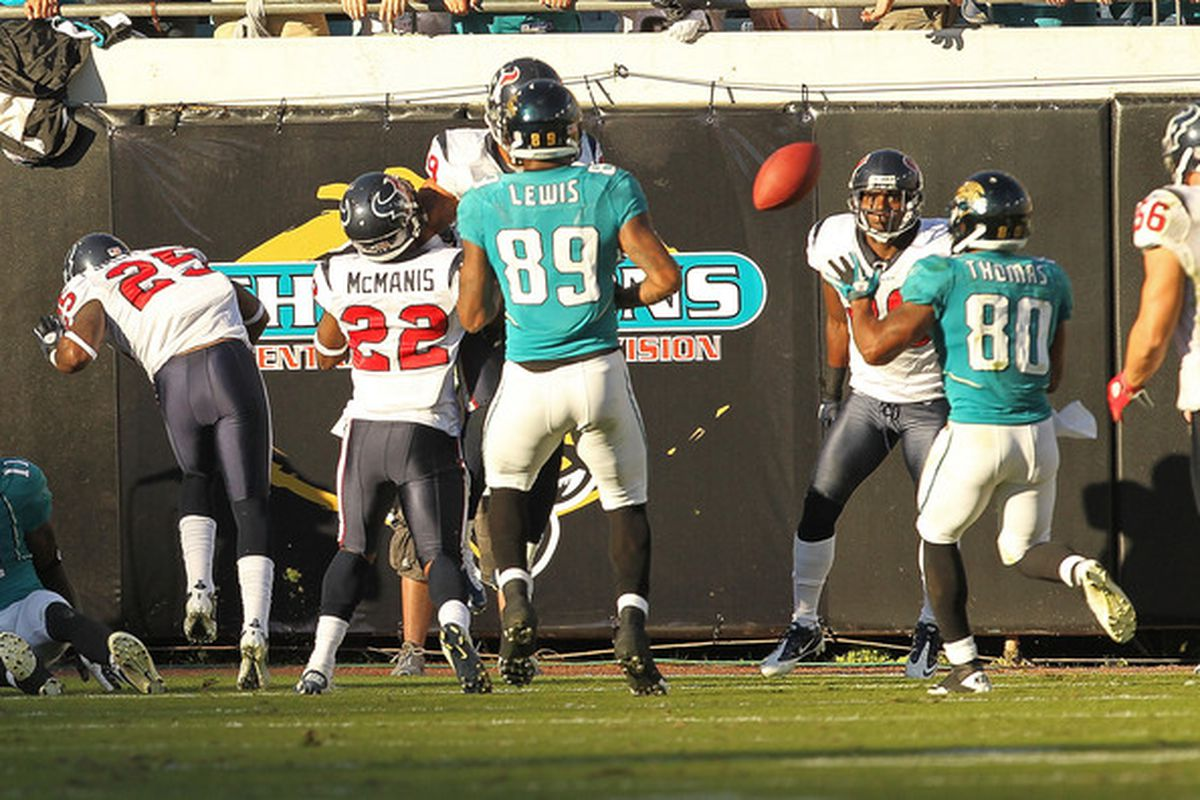 JACKSONVILLE FL - NOVEMBER 14:  Mike Thomas #80 of the Jacksonville Jaguars catches a tipped pass winning a game against the Houston Texans at EverBank Field on November 14 2010 in Jacksonville Florida.  (Photo by Mike Ehrmann/Getty Images)