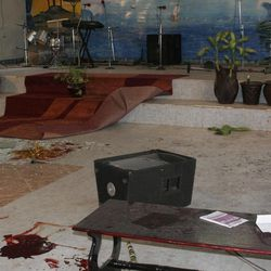 Blood is seen on the floor of a church after a grenade attack on a church in downtown Nairobi, Kenya, Sunday, April 29, 2012, where 1 person died and more than a dozen were injured.  The incident is the latest in a string of grenade attacks since Kenya sent troops into Somalia in October last year.