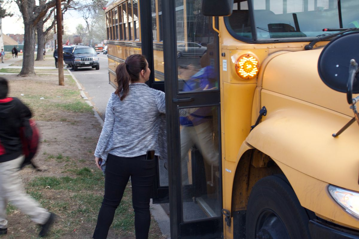 School officials help students getting off the Success Express buses at University Prep in Denver last week.