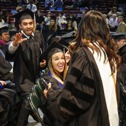"""Salt Lake Community College graduates reach out to 2017 commencement speaker actress Diane Guerrero, star of """"Orange Is the New Black"""" and """"Jane the Virgin,"""" during the commencement ceremony at the Maverik Center in West Valley City on Friday, May 5, 2017."""