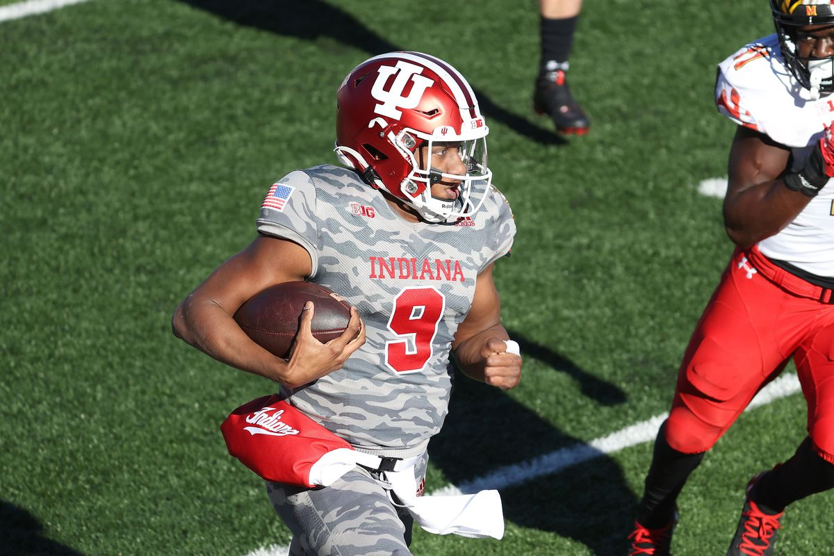 Michael Penix Jr of the Indiana Hoosiers runs with the ball against the Maryland Terrapins during the game at Memorial Stadium on November 28, 2020 in Bloomington, Indiana.