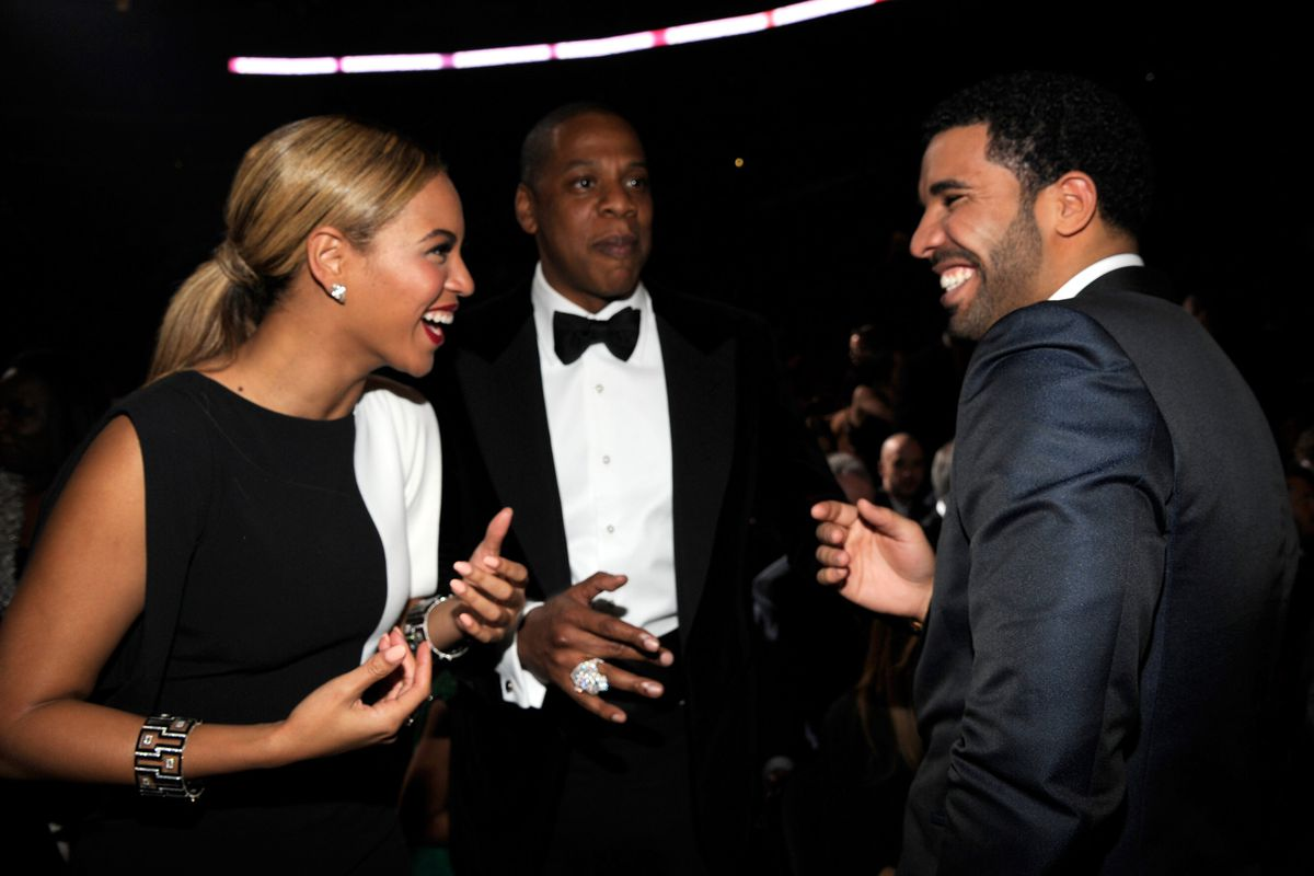 Beyoncé, Jay-Z, and Drake laughing together in simpler times.