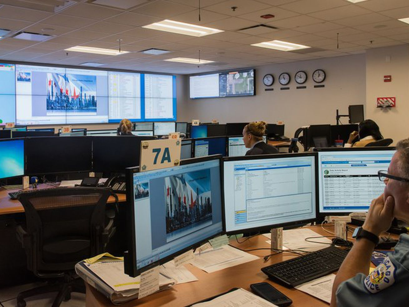 Chicago police officials working in the department's Crime Prevention and Information Center when detectives were using Clearview AI facial recognition technology.