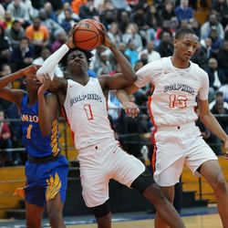 Young's Sangolay Njie (1)  hauls in a rebound against Simeon's Jaylen Drane (1), Wednesday 02-13-19. Worsom Robinson/For the Sun-Times.
