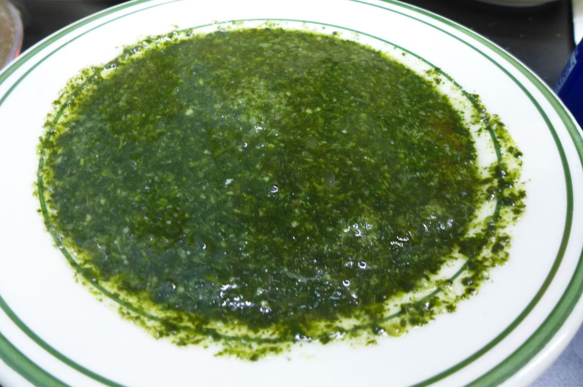 A broad bowl of very green and slimy soup.