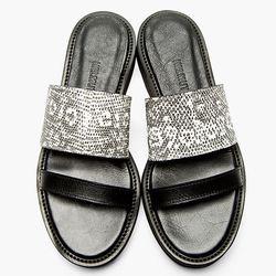 "<b>Helmut Lang</b> Schist sandal, <a href=""http://www.ssense.com/women/product/helmut_lang/black_and_white_leather_reptile_schist_sandals/98837"">$495</a>"