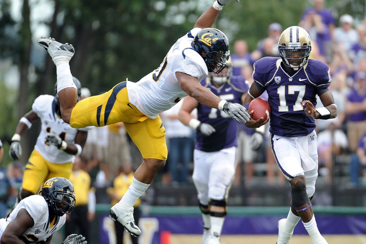SEATTLE, WA - SEPTEMBER 24:  Keith Price #17 of the Washington Huskies scrambles away from Mychal Kendricks #30 during the first quarter at Husky Stadium on September 24, 2011 in Seattle, Washington.  (Photo by Harry How/Getty Images)