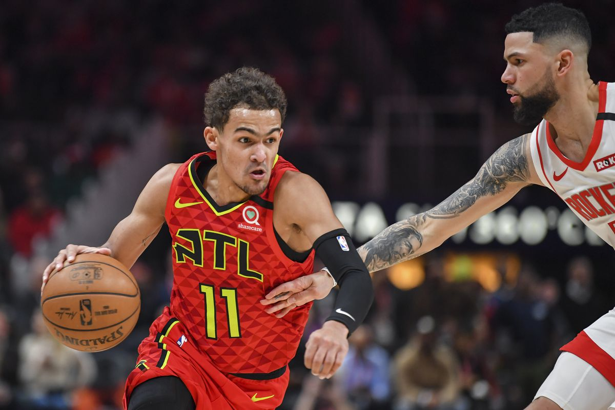 Atlanta Hawks guard Trae Young dribbles defended by Houston Rockets guard Austin Rivers during the second half at State Farm Arena.