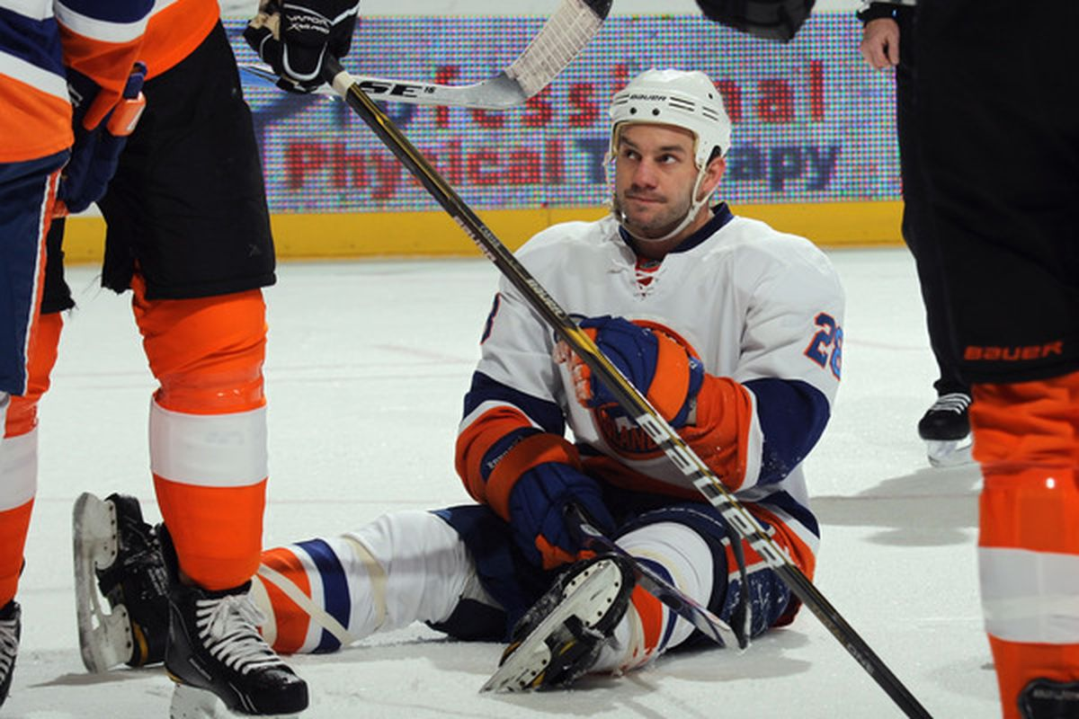 UNIONDALE NY - DECEMBER 05: Zenon Konopka #28 of the New York Islanders pauses after a play stoppage in his game against the Philadelphia Flyers at the Nassau Coliseum on December 5 2010 in Uniondale New York.  (Photo by Bruce Bennett/Getty Images)