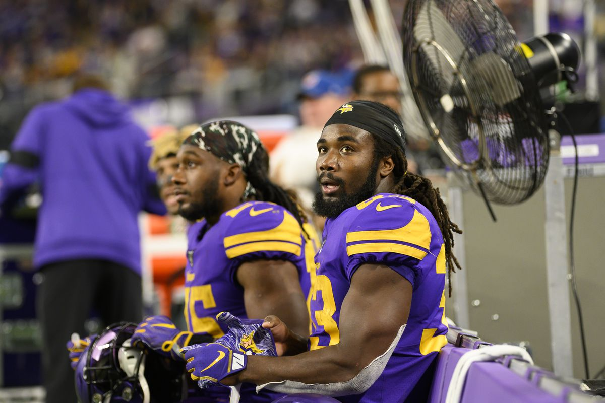 Dalvin Cook #33 of the Minnesota Vikings sits on the bench after scoring a touchdown in the second quarter of the game against Washington at U.S. Bank Stadium on October 24, 2019 in Minneapolis, Minnesota.