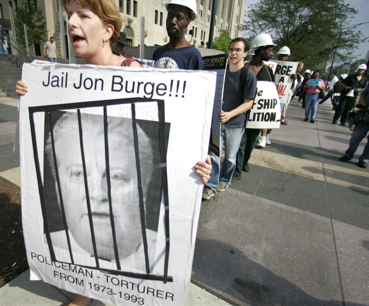 Kristin Roberts and others protest outside the Leighton Criminal Courthouse in 2006, demanding the release of a report on allegations that some Chicago police officers tortured suspects. Burge led a crew of detectives accused of torturing more than 100 su