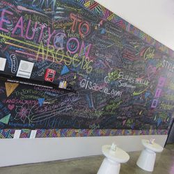 Aspiring makeup artists and stylists left their marks (and social media handles) on the event's community shout-out board.