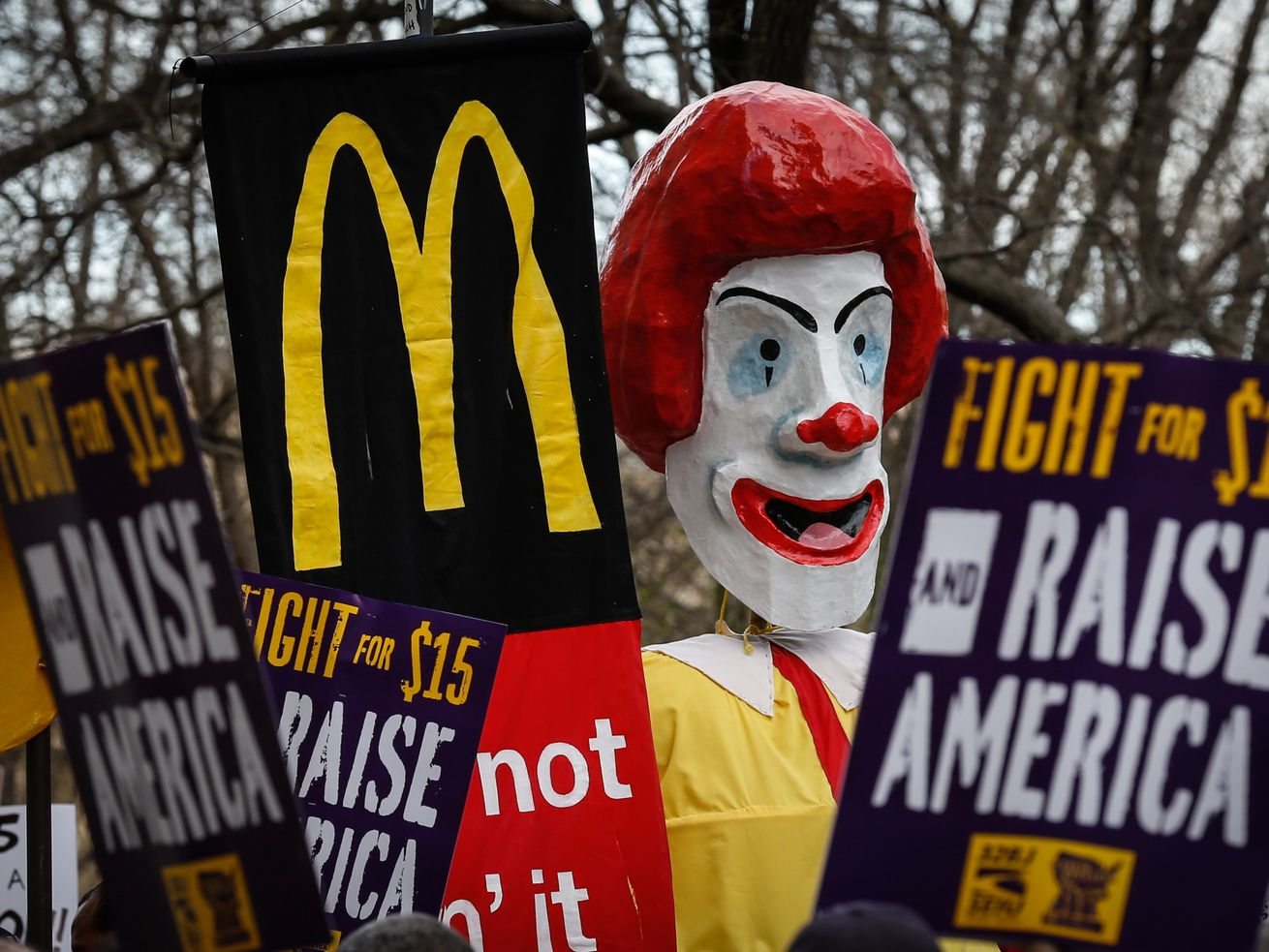Fast-food workers rally for a $15 hourly minimum wage on April 15, 2015, in New York City.