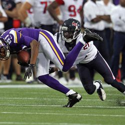 Aug 9, 2013; Minneapolis, MN, USA; Minnesota Vikings wide receiver Jerome Simpson (81) is tackled by Houston Texans cornerback Brice McCain (21) during the first quarter at the Metrodome.