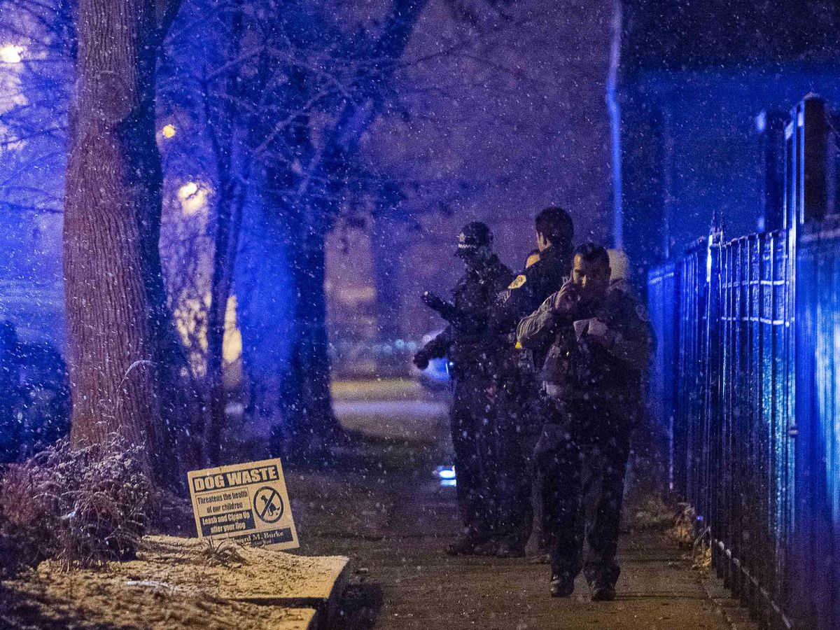 Chicago police and fire department respond to the scene of a person shot and killed Sunday morning in the 5200 block of South Artesian, in the Gage Park neighborhood. | Tyler LaRiviere/Sun-Times