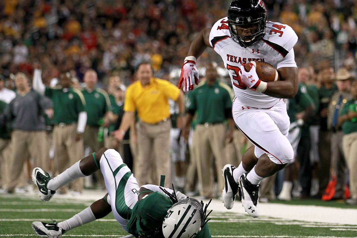 ARLINGTON, TX - NOVEMBER 26:  Kenny Williams #34 of the Texas Tech Red Raiders runs for a touchdown past Glasco Martin #8 of the Baylor Bears at Cowboys Stadium on November 26, 2011 in Arlington, Texas.  (Photo by Ronald Martinez/Getty Images)