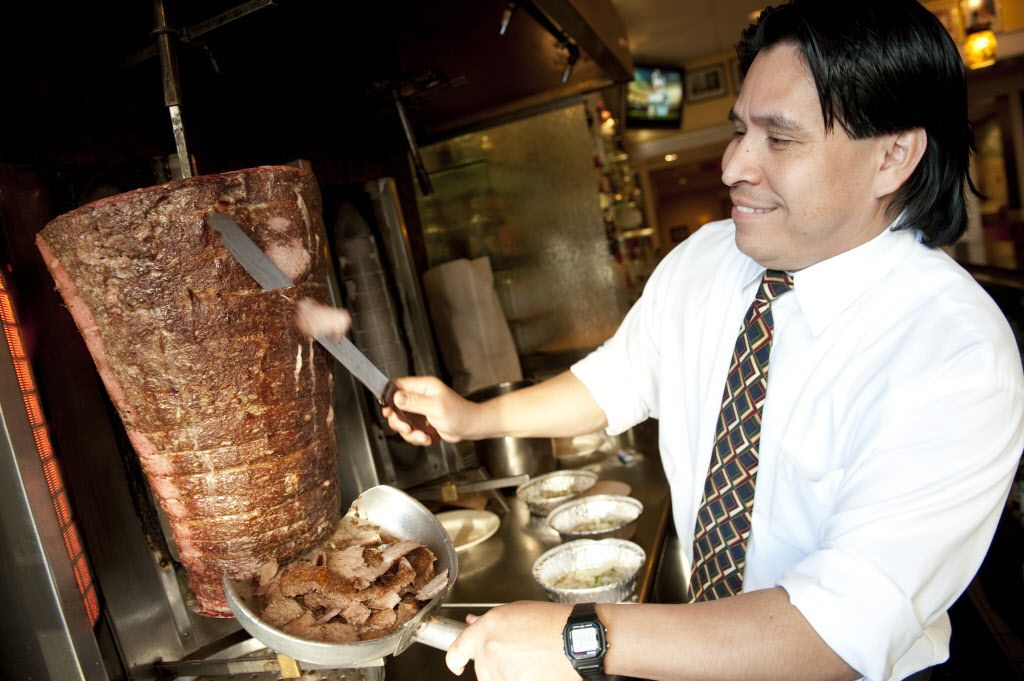 Jose Jaimes slices gyros at The Parthenon, 314 S. Halsted in 2011. File Photo   Jean Lachat~Sun-Times