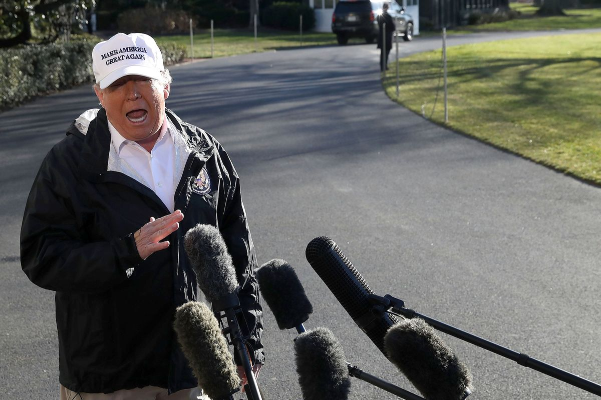 President Donald Trum speaks with the media amid a partial government shutdown in January 2019.