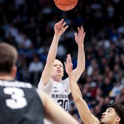 Brigham Young Cougars guard TJ Haws (30) shoots over Gonzaga Bulldogs guard Ryan Woolridge (4) at the Marriott Center in Provo on Saturday, Feb. 22, 2020.