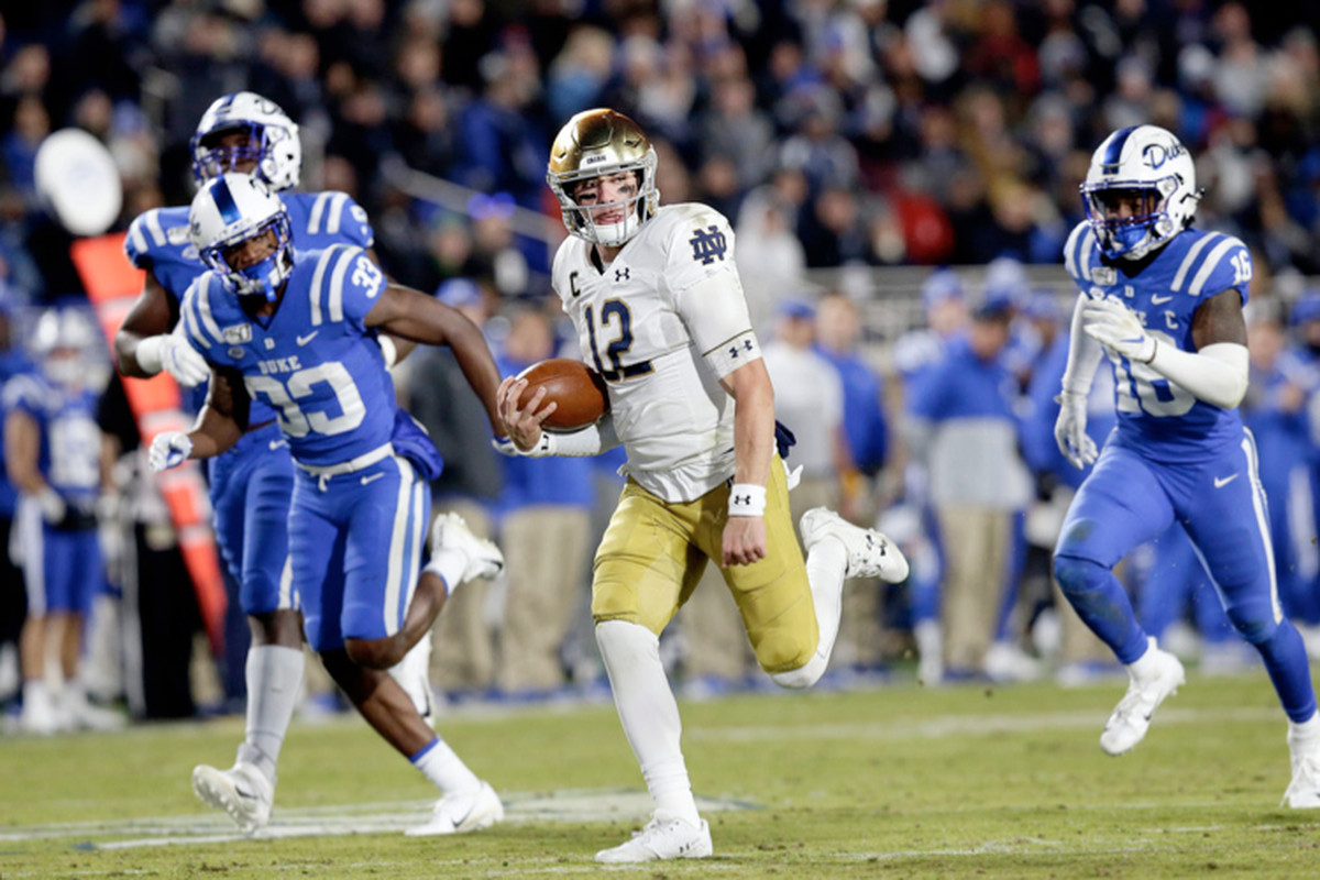 Notre Dame quarterback IanBook rushed for a career-high 139 yards and threw four touchdown passes on Saturday against Duke in Durham, N.C.