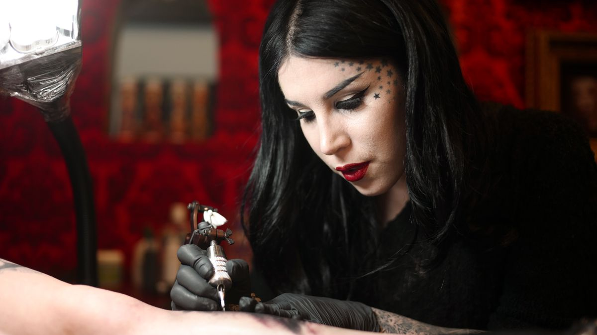 3b85edd79 Kat Von D tattoos a person's arm at her West Hollywood tattoo studio.