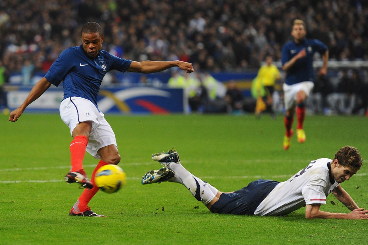 PARIS, FRANCE - NOVEMBER 11:  Loic Remy of France scores as Clarence Goodson of USA trips during the International Friendly between France and USA at Stade de France on November 11, 2011 in Paris, France.  (Photo by Mike Hewitt/Getty Images)