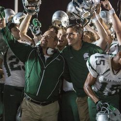 """Jim Caviezel (center-right), Alexander Ludwig (center) and Michael Chiklis (center-left) star in """"When the Game Stands Tall."""""""