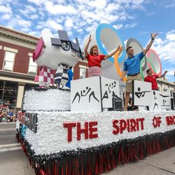 Members of the press ride on the KSL float during the Grand Parade in Provo on Monday, July 5, 2021.