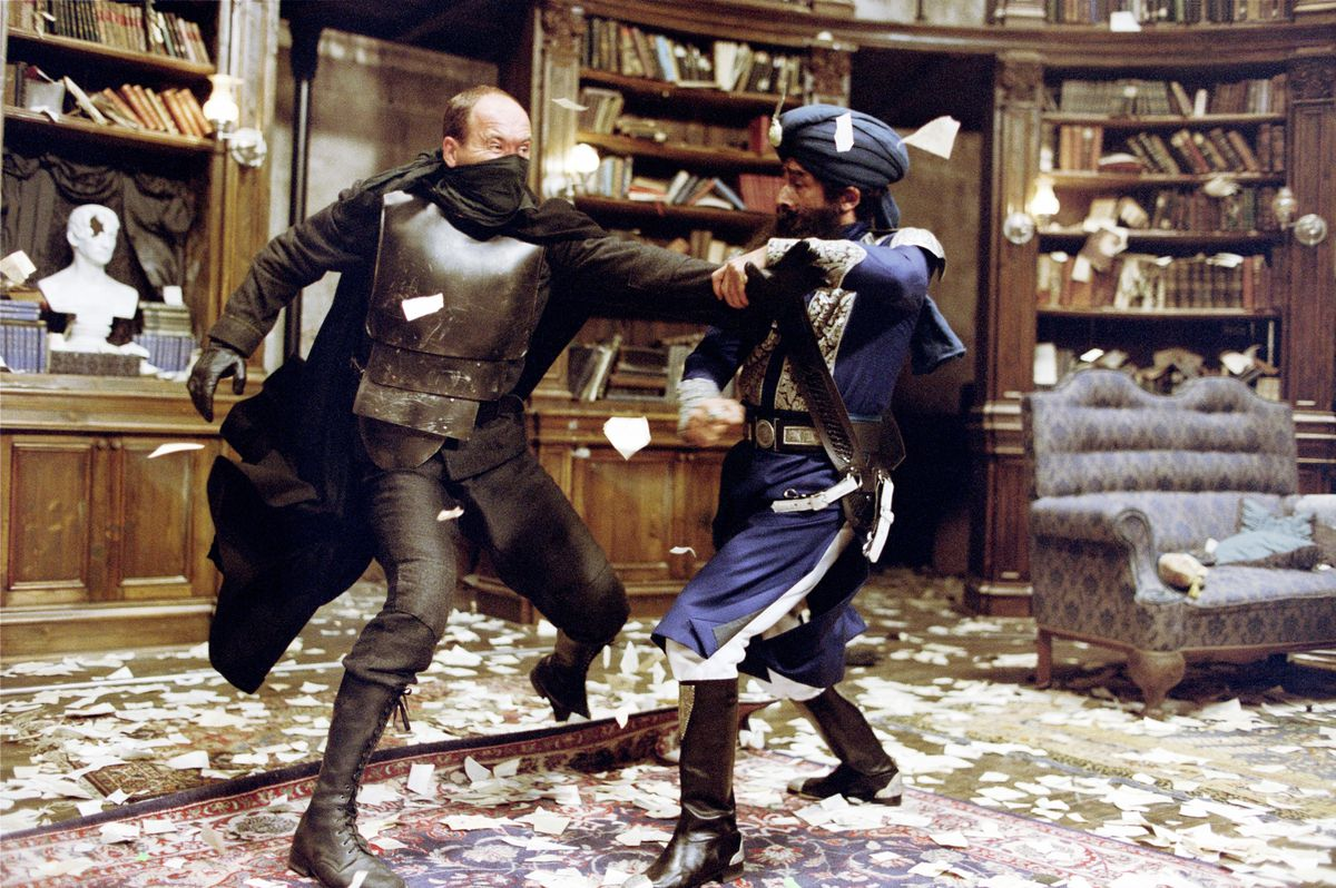Two men engaged in a fight.