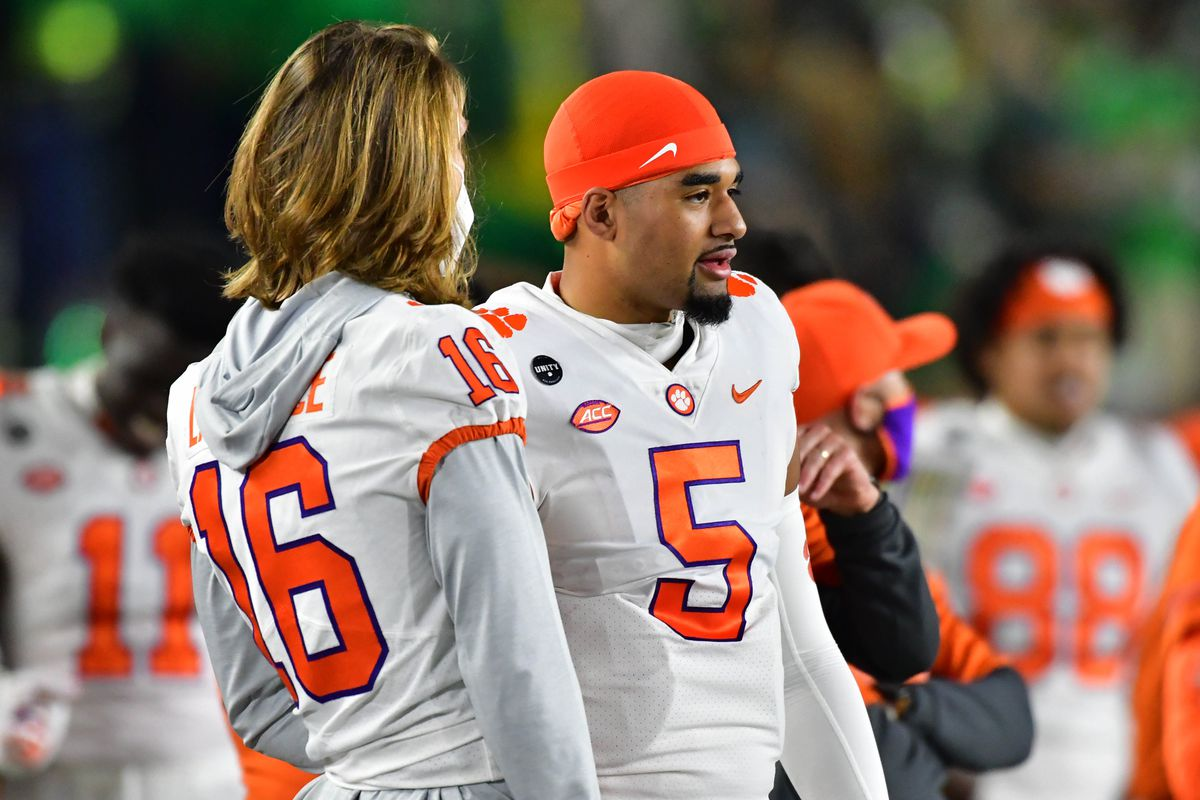 Quarterbacks Trevor Lawrence and D.J. Uiagalelei of the Clemson Tigers talk in the first quarter against the Notre Dame Fighting Irish at Notre Dame Stadium on November 7, 2020 in South Bend, Indiana.