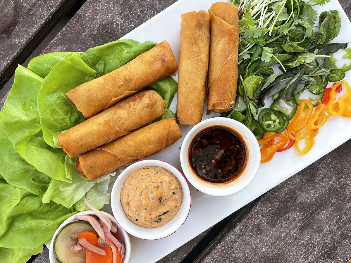 Lettuce wrap platter with veggie egg rolls and two dipping sauces