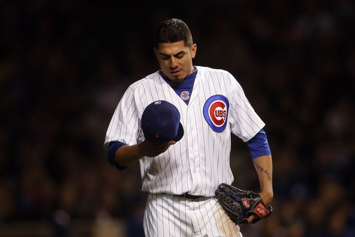 May 16, 2012; Chicago, IL, USA; Chicago Cubs starting pitcher Matt Garza reacts during the fifth inning against the Philadelphia Phillies at Wrigley Field. Mandatory Credit: Jerry Lai-US PRESSWIRE
