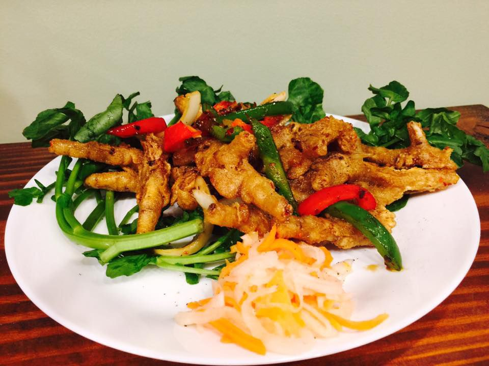 A dish of fried Vietnamese food with greens