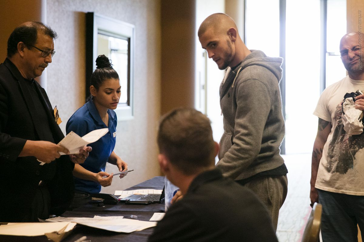 Dustin Poirier checks in for early weigh-ins the day before UFC 199 in LA.