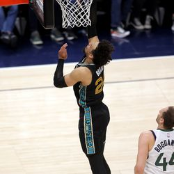 Memphis Grizzlies forward Dillon Brooks (24) gets behind the Jazz defense for a layup as the Utah Jazz fall to the Memphis Grizzlies play in game one of their NBA playoff series at Vivint Arena in Salt Lake City on Sunday, May 23, 2021. Memphis won 112-109.