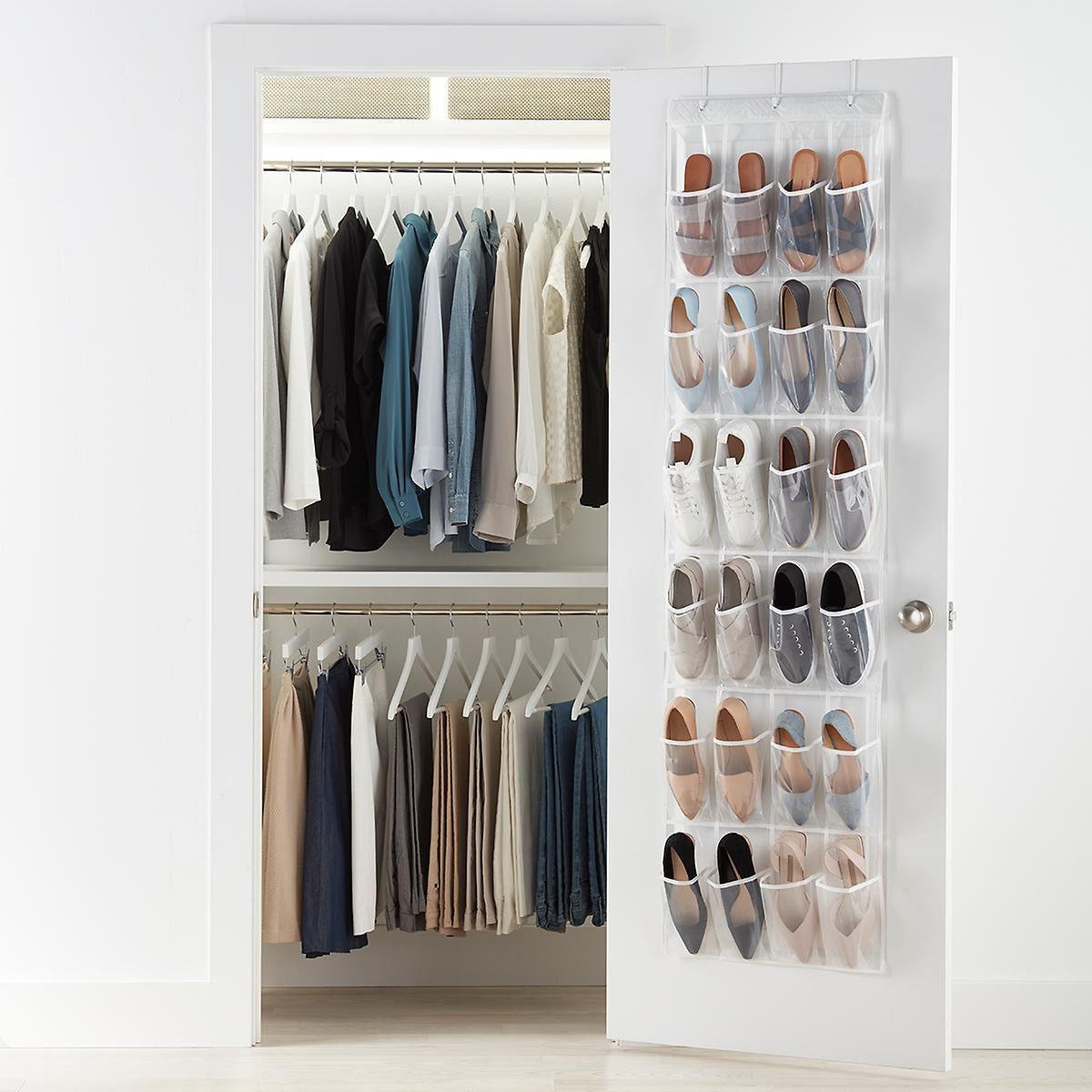 Door to a closet with an organizer hanging on the door.