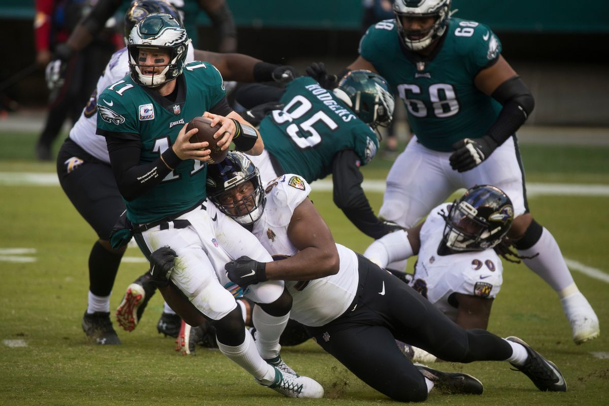 Eagles' Carson Wentz (11) is sacked by the Ravens' Calais Campbell (93) during the third quarter Sunday, Oct. 18, 2020.