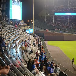 9:33 p.m. Fans in right field watching the Blackhawks -