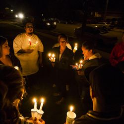 A candlelight vigil is held for the victims of a triple homicide at 639 N. Sir Philip Drive in Salt Lake City on Saturday, Sept. 19, 2015.