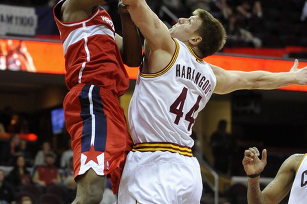 Apr 25, 2012; Cleveland, OH, USA;  Washington Wizards point guard John Wall (left) puts up a shot as Cleveland Cavaliers forward Luke Harangody (44) defends in the fourth quarter at Quicken Loans Arena. Mandatory Credit: David Richard-US PRESSWIRE