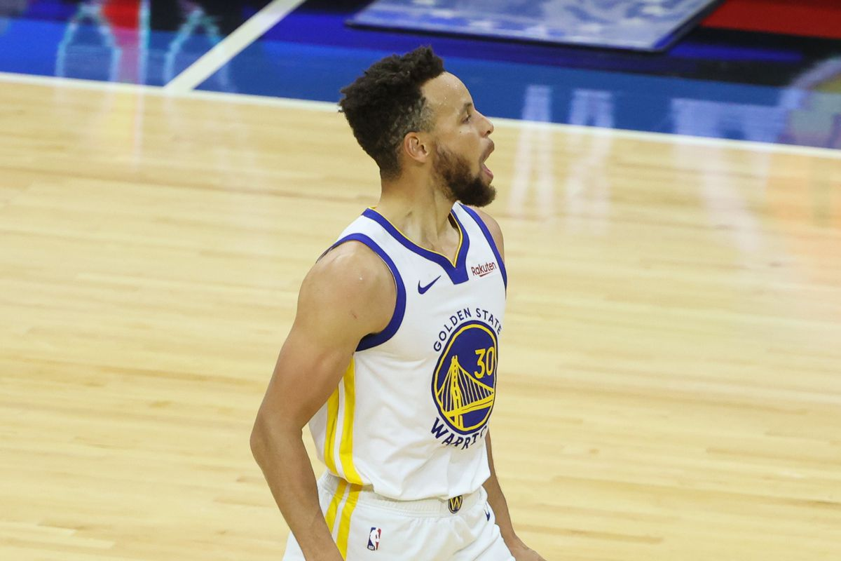 Golden State Warriors guard Stephen Curry reacts after a three pointer against the Philadelphia 76ers during the fourth quarter at Wells Fargo Center.