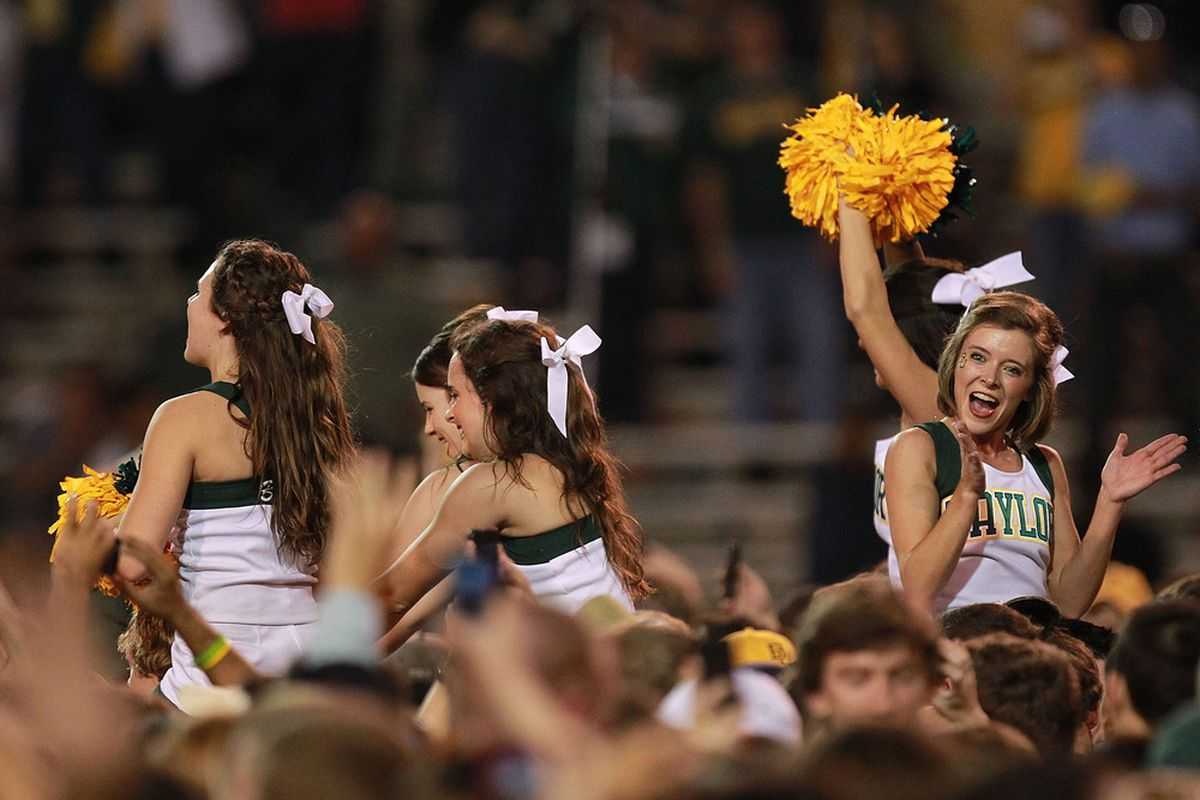 WACO, TX - NOVEMBER 19:  Baylor Bears cheerleaders celebrate on the field after a 45-38 win against the Oklahoma Sooners at Floyd Casey Stadium on November 19, 2011 in Waco, Texas.  (Photo by Ronald Martinez/Getty Images)